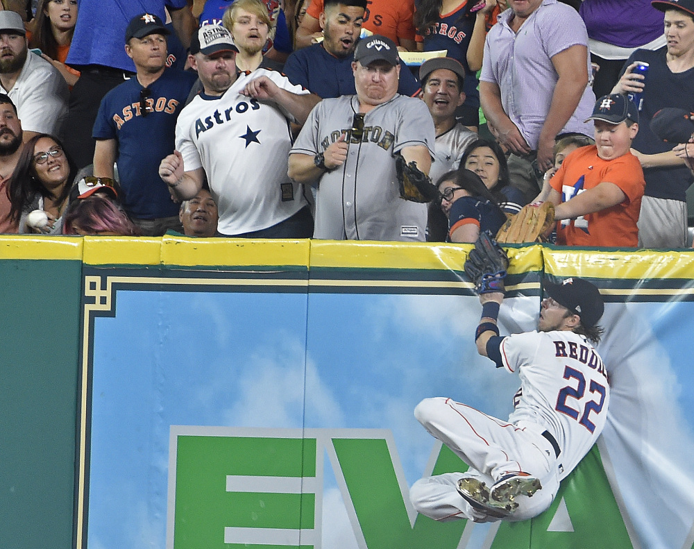 Houston right fielder Josh Reddick can't catch a long drive by the Rangers' Joey Gallo, which goes for a triple in the second inning Monday in Houston.
