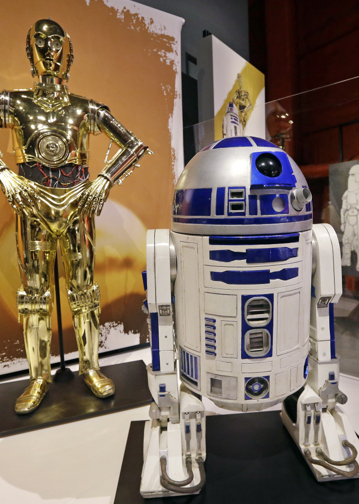 C-3PO, left, and R2-D2 costumes are shown in a previous exhibit at Seattle's EMP Museum.