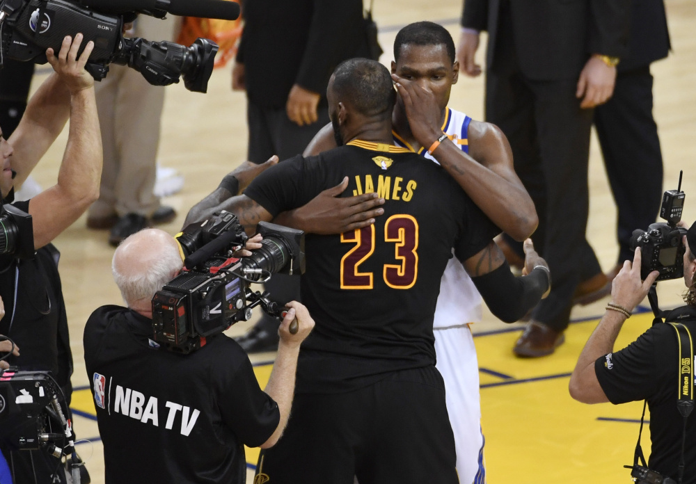 LeBron James hugged Kevin Durant after the NBA finals Monday night but make no mistake. He wants another shot at the star-laden Golden State Warriors. The question is how his Cleveland Cavaliers can reassemble a team that would pose a definite threat.