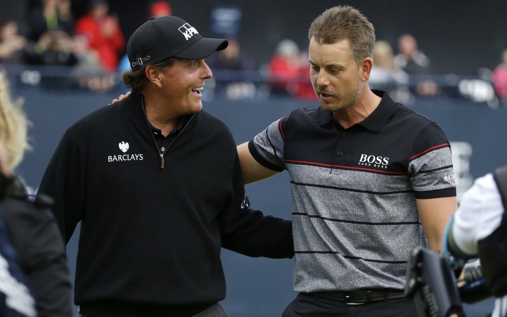 Phil Mickelson, left, and Henrik Stenson staged a memorable duel in the British Open last year. This year's U.S. Open course has elements of a British links, but figures to prove much tougher with tall grass off the fairways and ill-maintained bunkers.