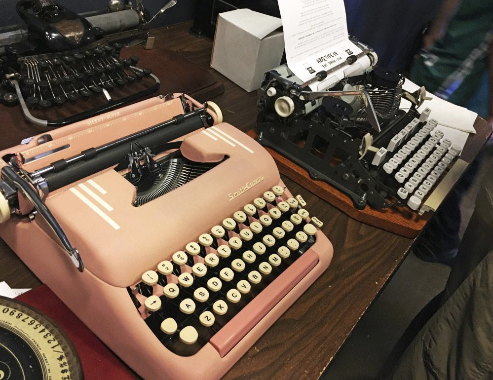 Vintage typewriters are on display at a