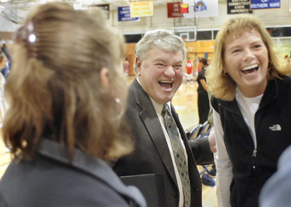Gary Fifield laughs with former players during a ceremony honoring him at the University of Southern Maine in 2015.