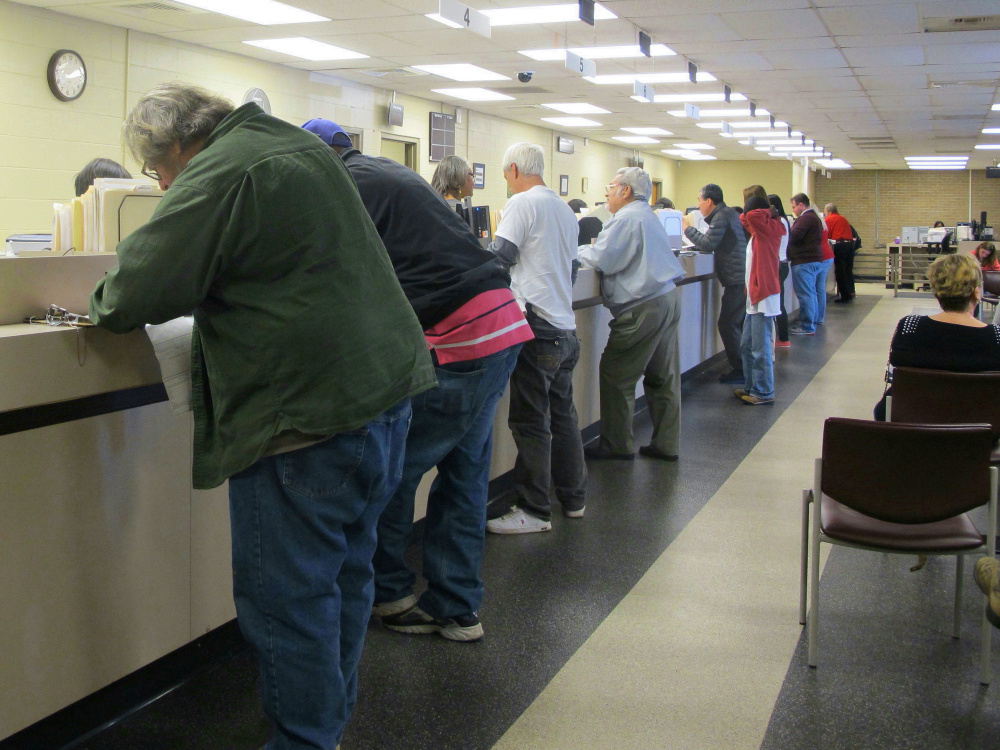 Motorists visit a South Carolina Department of Motor Vehicles office during a program that allowed some people with suspended licenses to get them reinstated. Many states have opted out of a federal law that calls for stripping drug offenders' licenses; the governor of Maine, Paul LePage, would like the state to sign on to the federal statute.