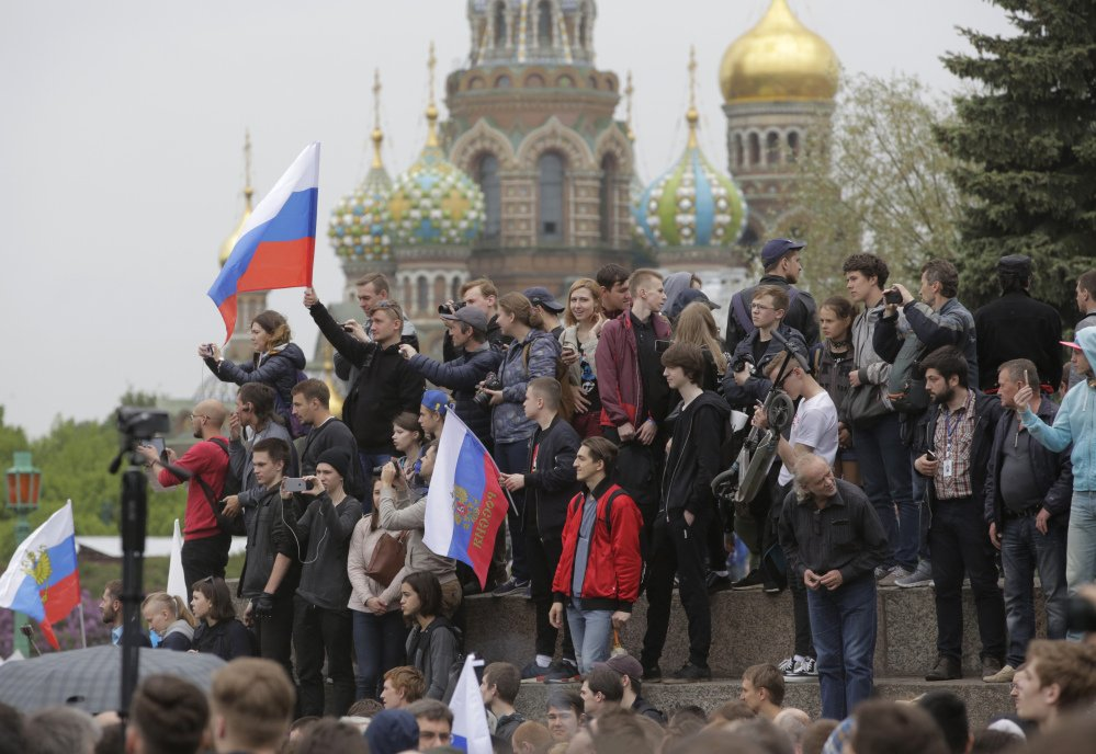 People gather for an anti-corruption rally in St. Petersburg, Russia.The protest gatherings in cities from Far East Pacific ports to St. Petersburg were spearheaded by Alexei Navalny, the anti-corruption campaigner.