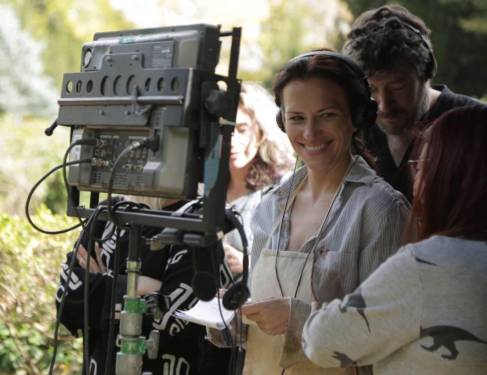"Catherine Eaton, in headphones, directs ""The Sounding,"" a mystery that was filmed partly on Monhegan Island. Eaton also co-wrote and acted in the movie, which will open the Maine International Film Festival July 14 in Waterville. The 10-day festival features more than 100 American and foreign films."