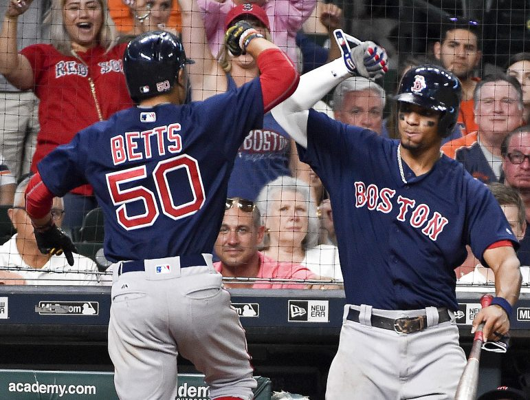 Boston's Mookie Betts celebrates his go-ahead home run off Houston reliever Will Harris with Xander Bogaerts during the eighth inning of Friday night's game in Houston.