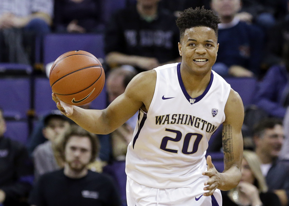 Markelle Fultz, the Washington guard expected to be the top overall pick in Thursday's NBA draft, works out for Philadelphia on Saturday as rumors regarding a trade of the pick between the 76ers and Boston Celtics picked up steam. (Associated Press/Elaine Thompson)