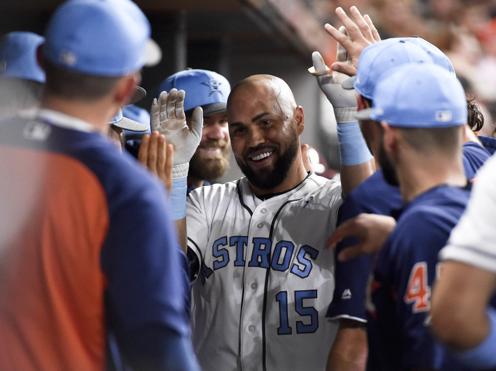 Carlos Beltran celebrates with Astros teammates after his two-run homer off Red Sox starter Rick Porcello during the third inning of Houston's 7-1 win Saturday. (AP Photo/Eric Christian Smith)