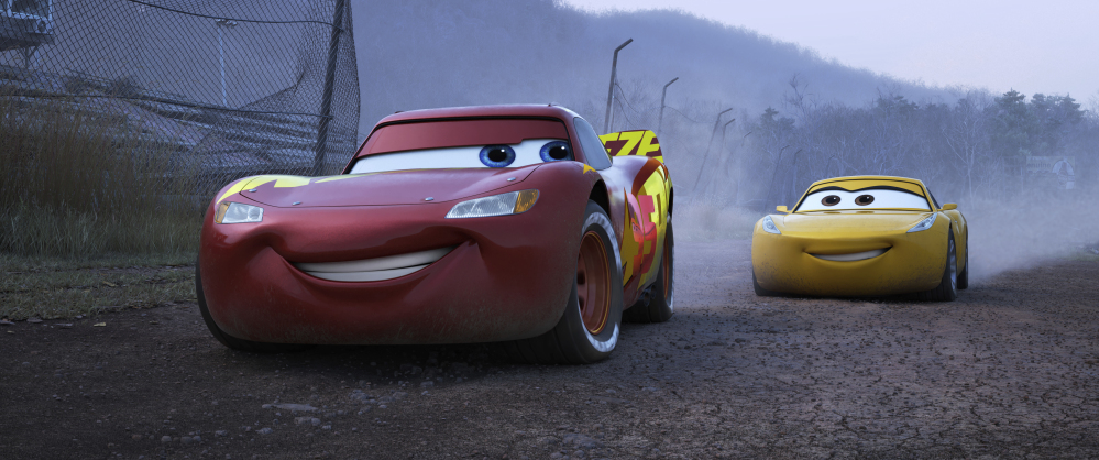 "Lightning McQueen, voiced by Owen Wilson, left, and Cruz Ramirez, voiced by Cristela Alonzo, in a scene from ""Cars 3."""