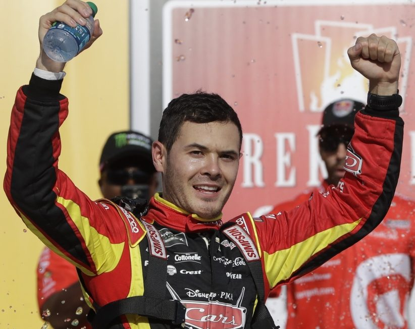 Kyle Larson celebrates his second win of the season on Sunday. It was Larson's third career win, and his second straight at Michigan.