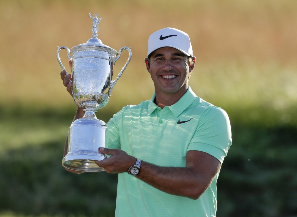 Brooks Koepka poses with the championship trophy after winning the U.S. Open on Sunday in Erin, Wis.