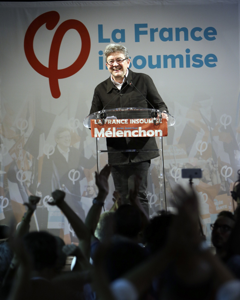 Far-left ex-presidential candidate and candidate in the parliamentary elections Jean-Luc Melenchon celebrates with his supporters after winning his race for a parliamentary seat in Marseille southern France, Sunday, June 18, 2017. French voters are casting ballots Sunday in the final round of parliamentary elections that could clinch President Emmanuel Macron's hold on power, as his fledgling party appears set to rout mainstream rivals and turn politics as usual on its head.(AP Photo/Claude Paris)