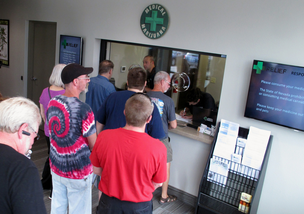 People line up to be among the first in Nevada to legally purchase medical marijuana at the Silver State Relief dispensary in Sparks, Nev., in 2015. Nevada's marijuana regulators are working to launch recreational sales on July 1, a deadline that could hinge on a court deciding whether the state's liquor industry should be guaranteed a piece of the pot pie before tourists and residents can light up.