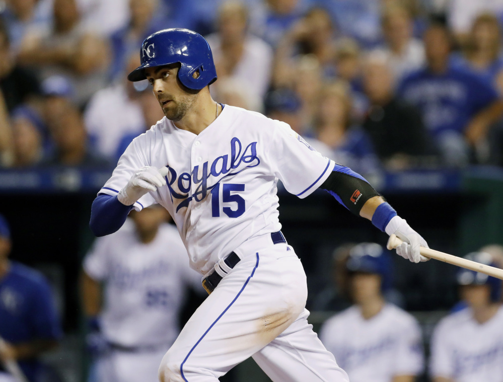 Whit Merrifield hits a single, driving in the go-ahead run against the Red Sox in the seventh inning. Kansas City held off the Red Sox in the last two innings to win.