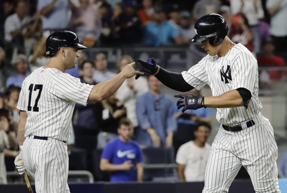 The Yankees' Aaron Judge, right, celebrates with Matt Holliday after hitting his major league-leading 24th home run in the fifth inning Tuesday night, but the Angels went on to an 8-3 victory.
