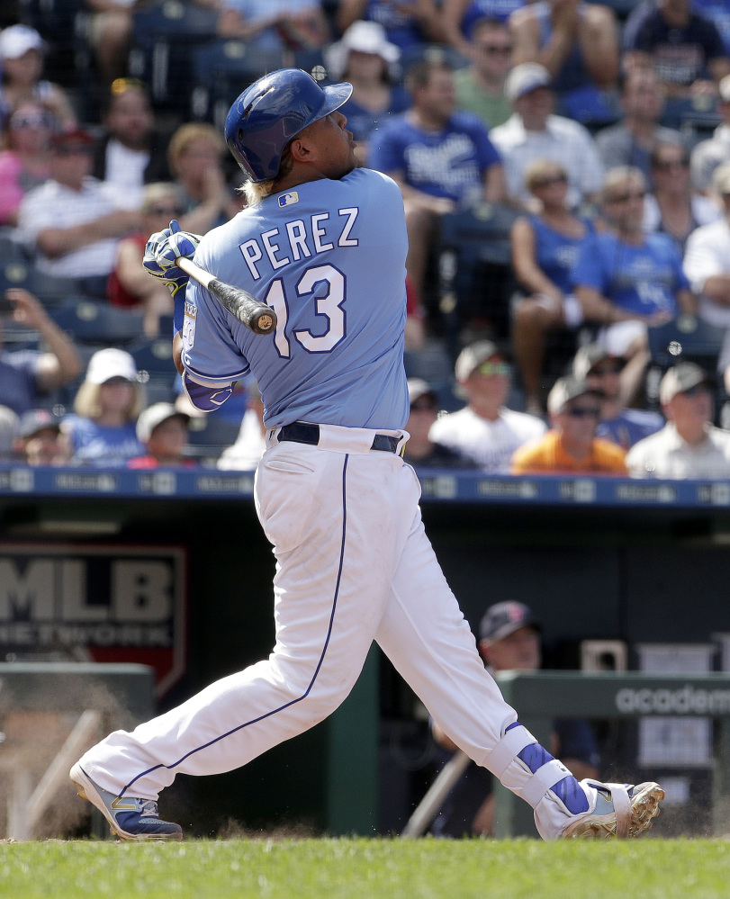 The Royals' Salvador Perez watches his grand slam in the eighth inning Wednesday. The home run, Perez's first career grand slam, gave Kansas City a 6-4 win over the Red Sox.