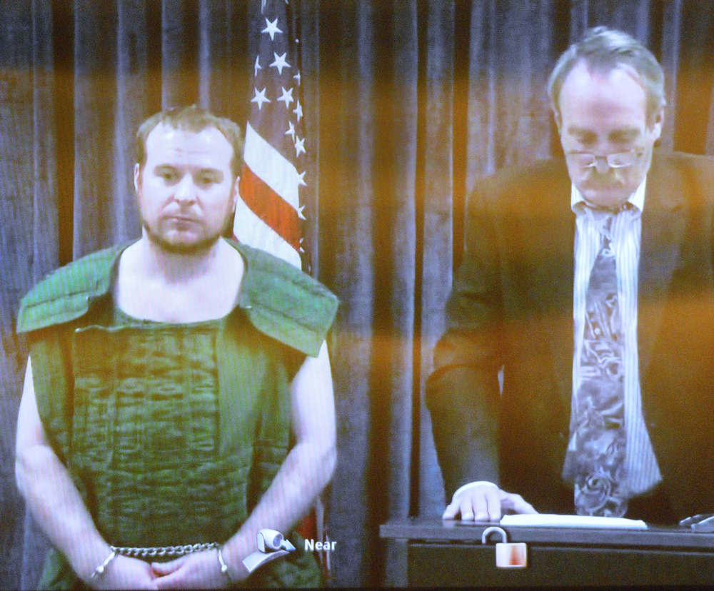 Jeremy Clement and his attorney, Steve Bourget, appear on video from the Kennebec County Jail during his initial appearance April 21 in the Capital Judicial Center in Augusta.