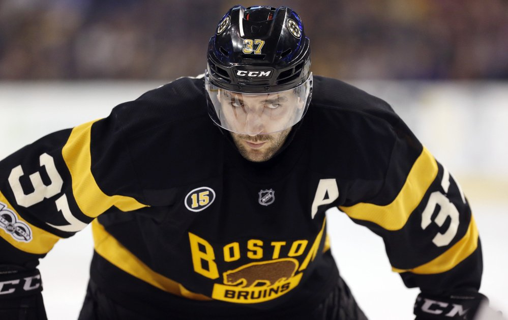 Boston's Patrice Bergeron waits for a faceoff during a March 4 game against the Devils. Winning faceoffs was just one of Bergeron's defensive contributions – and something he did more than any other player last season.