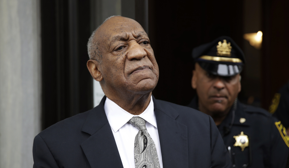 Bill Cosby exits the Montgomery County Courthouse after a mistrial was declared in his sexual assault trial.