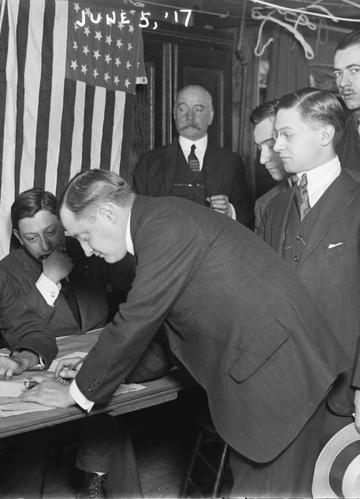 Young men in New York City register for the draft on June 5, 1917, two months after the United States entered World War I.