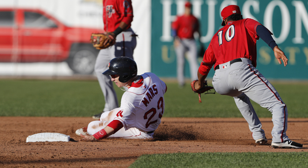 Danny Mars of the Portland Sea Dogs slides past Osvaldo Abreu of the Harrisburg Senators and into second base Saturday night during the second inning of Portland's 6-5 setback at Hadlock Field.