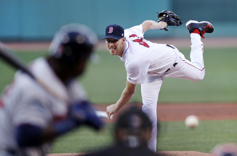 Red Sox starter Chris Sale delivers in the first inning against the Twins. Sale got the win, pitching into the seventh inning and giving up just one run on four hits.
