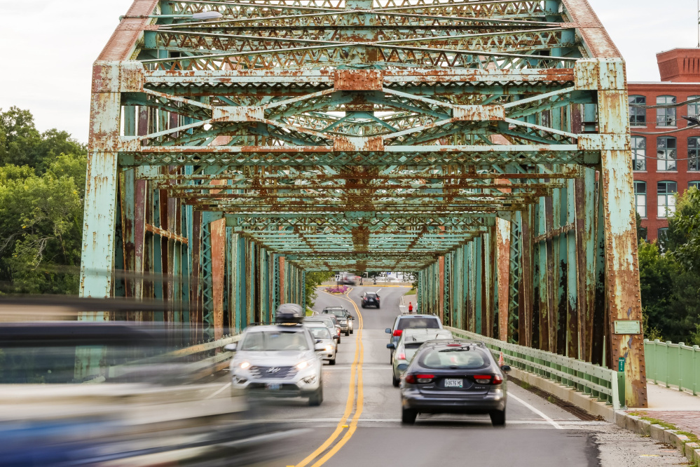 The Frank Woods Bridge between Brunswick and Topsham, showing its age in August 2016, should be replaced rather than renovated, says the Maine Department of Transportation.