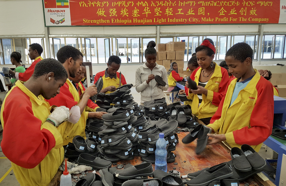 In this Thursday, Jan. 5, 2017, photo, Ethiopian factory workers sort shoes at the Chinese company Huajian's plant in Addis Ababa, Ethiopia. Workers from at Ganzhou Huajian International Shoe City Co., a southeastern China factory used by Ivanka Trump and other fashion brands, say they've faced long hours, low pay and verbal abuse. Huajian, meanwhile, has been moving production to Ethiopia, where workers make around $100 a month, a fraction of what they pay in China, according to Song Yiping, a manager at Huajian's Ethiopian factory, who spoke to the Associated Press in January. (AP Photo/Elias Meseret)