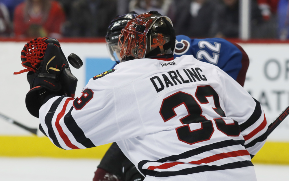 Scott Darling, the former UMaine goalie, wanted to keep No. 33 after moving from Chicago to Carolina. He got it after bargaining through Twitter with a new teammate.