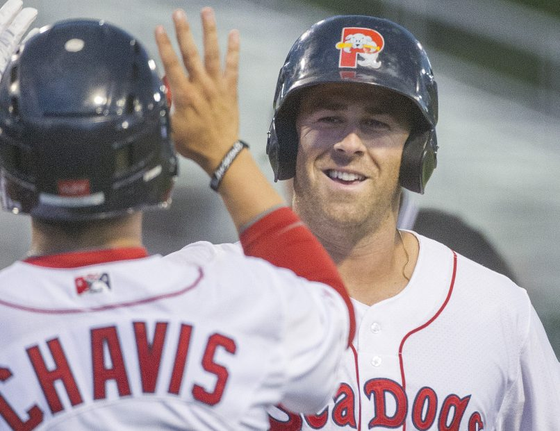 Mike Olt of the Portland Sea Dogs is met by teammate Michael Chavis after hitting a two-run homer Tuesday night. The Sea Dogs beat the New Hampshire Fisher Cats 2-1 when rain ended the game in the sixth inning.