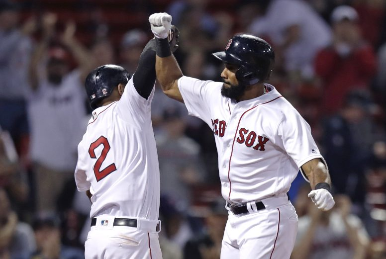 Boston Red Sox's Chris Young, right, is congratulated by Xander Bogaerts after his three-run home run during the sixth inning Tuesday against the Minnesota Twins at Fenway Park in Boston.