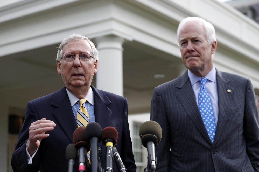 Senate Majority Leader Mitch McConnell of Kentucky, left, and Senate Majority Whip Sen. John Cornyn, R-Texas, speak with the media Tuesday as Republicans try to come up with a revised health care bill.