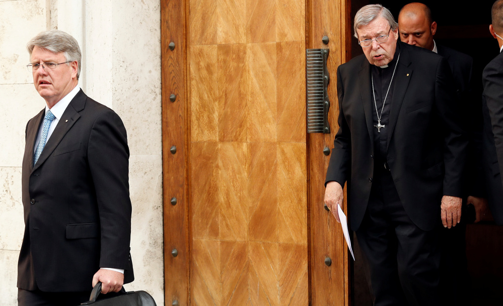 Cardinal George Pell leaves his house in Rome Thursday. One of the most powerful officials in the Vatican, he said he would return to his native Australia to fight the assault charges.