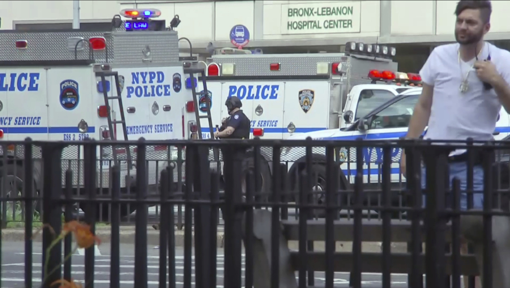 In this image taken from video, emergency personnel converge on Bronx Lebanon Hospital in New York, after a gunman opened fire there on Friday.