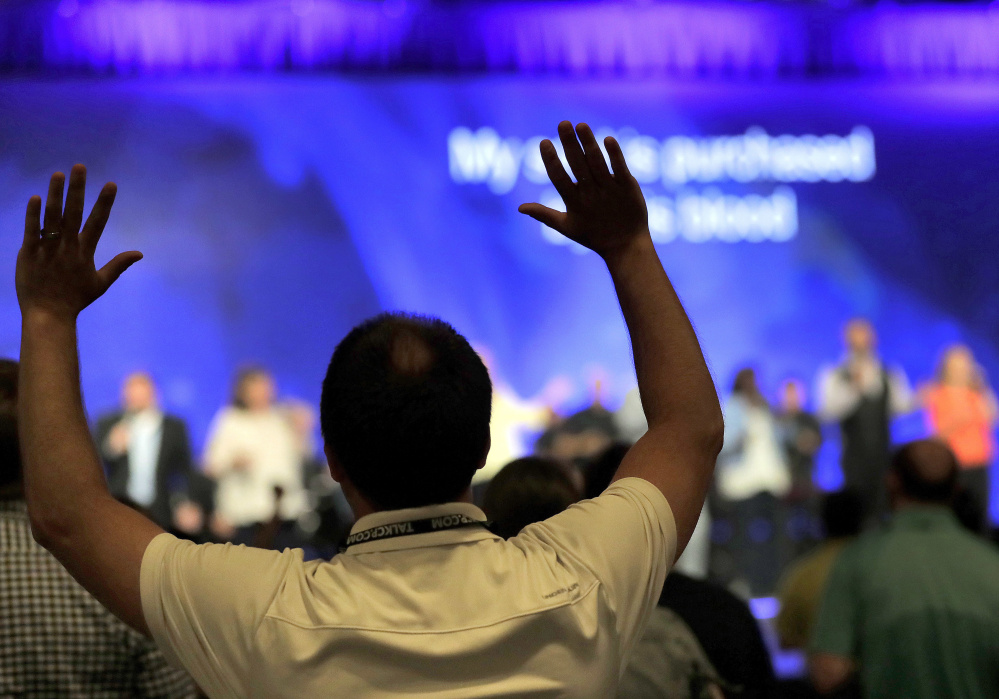 Conservative Christians pray during the Southern Baptist Convention's annual meeting last month in Phoenix. Research suggests that the nonsecular world is evolving with the secular when it comes to same-sex issues and overall support for LGBT issues.