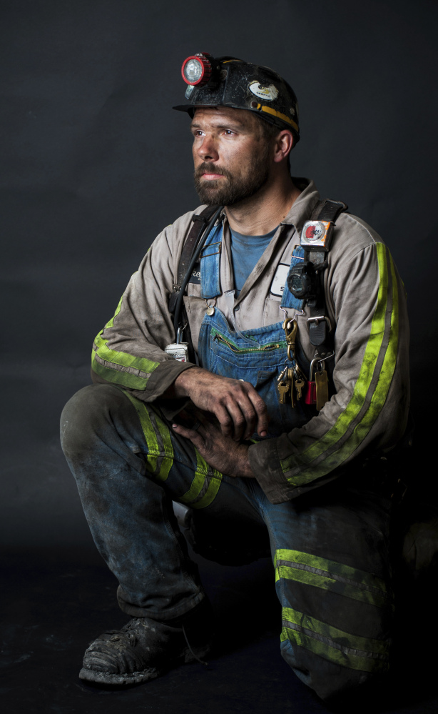 Coal miner Rickey Thorpe poses for a photo that became a Mother's Day gift. Thorpe, who worked in a mine in western Kentucky, was killed in a workplace accident Sept. 16, 2015. Thorpe's mother, Kathy Bartlett, is critical of a new law in Kentucky that reduces safety inspections at underground mines.