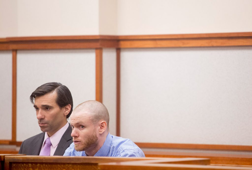 Justin Kristiansen, right, and his attorney, Luke Rioux, appear in court May 8. Kristiansen is accused of stabbing a cab driver in Portland.