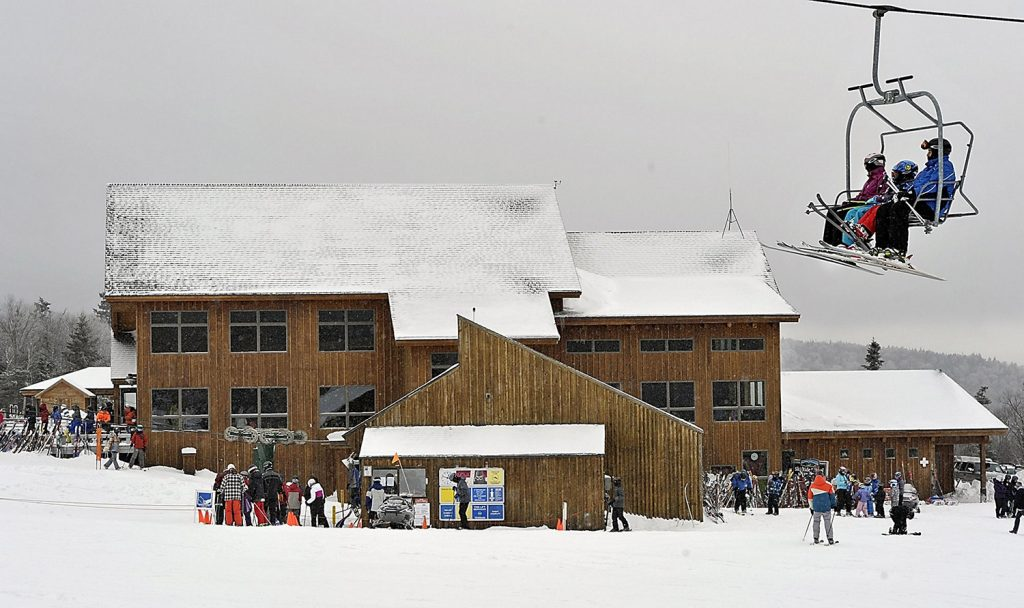 Skiers ride the South Branch chairlift at Saddleback in December 2012. The ski area's need for a new chairlift to the summit was originally cited as the reason for its shutdown in 2015.
