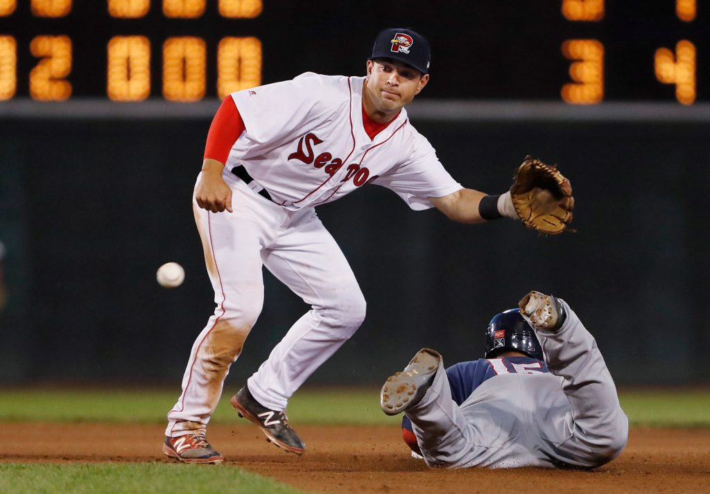 Portland's Chad De La Guerra reaches out for a catch at second as New Hampshire's Harold Ramirez slides in during the seventh inning of their game Monday night at Hadlock Field