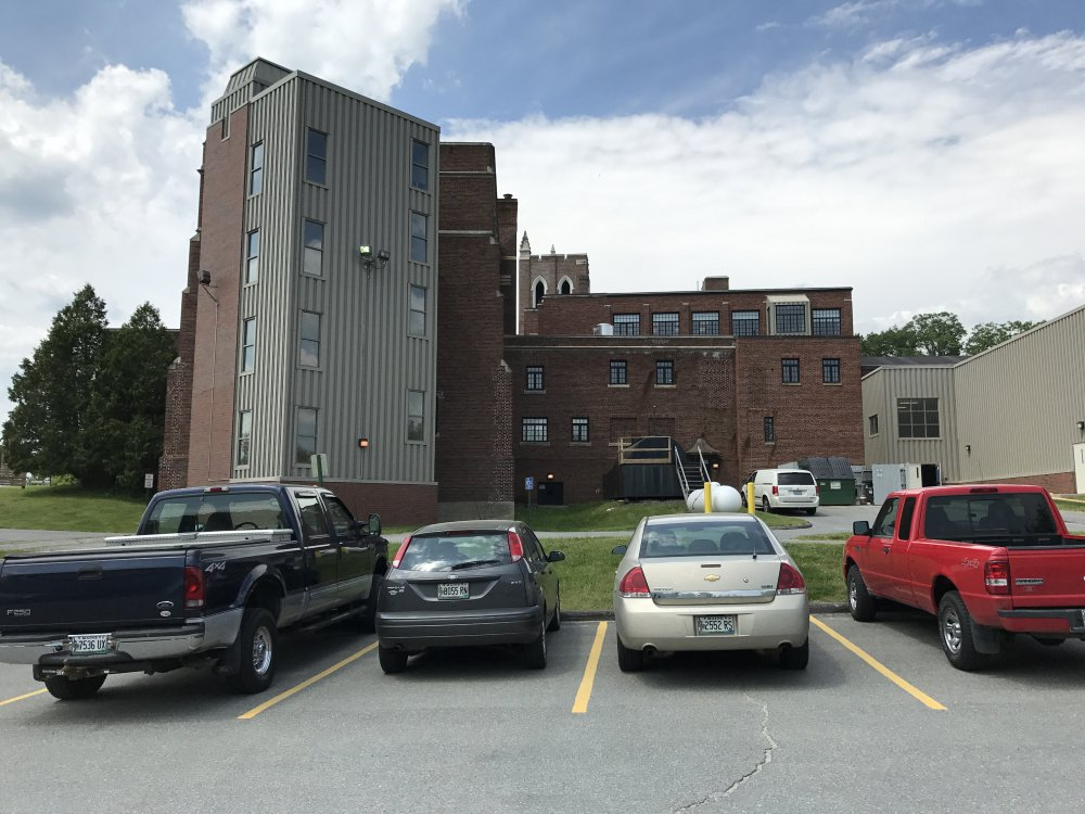 The Maine Criminal Justice Academy in Vassalboro is seen from its rear parking lot, where authorities said an accidental shooting happened Monday night that left a county corrections officer with a serious gunshot wound to the leg.