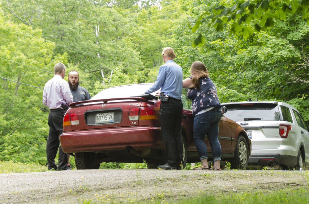 Detectives investigate a shooting death on Yeaton Drive in West Gardiner in this file photo.