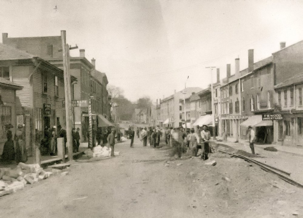 Workers build trolley tracks down the middle of Hallowell's Water Street in 1890.