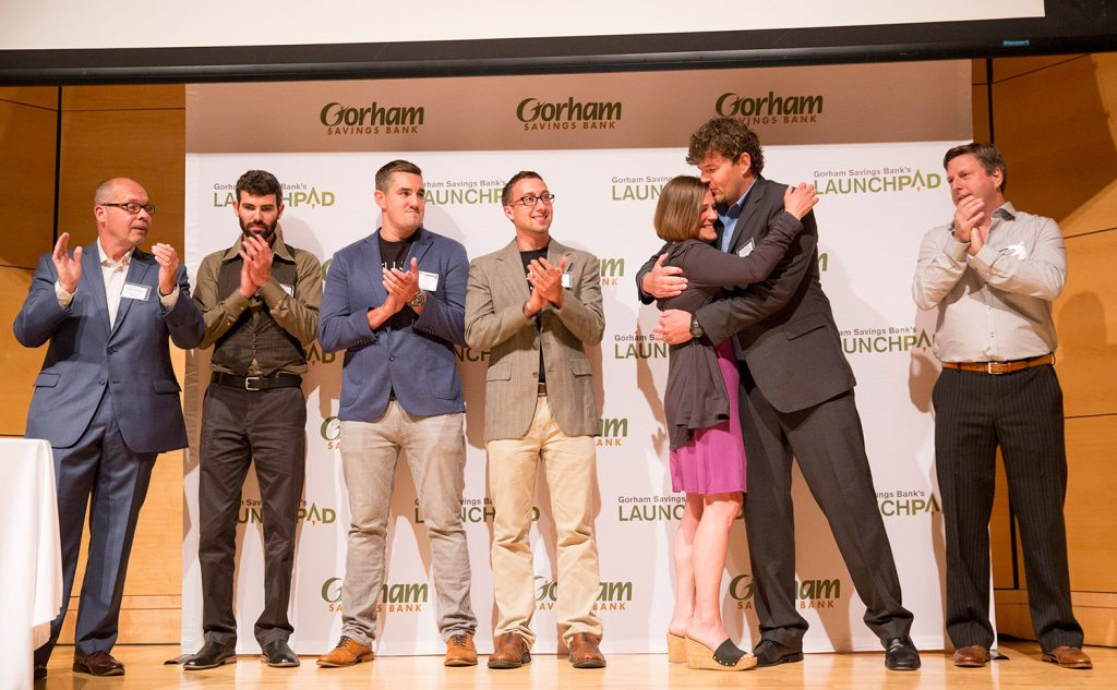 Jennifer Scism and David Koorits, owners of Good To-Go in Kittery, embrace as they're announced as the winners of Gorham Savings Bank's $50,000 LaunchPad prize.