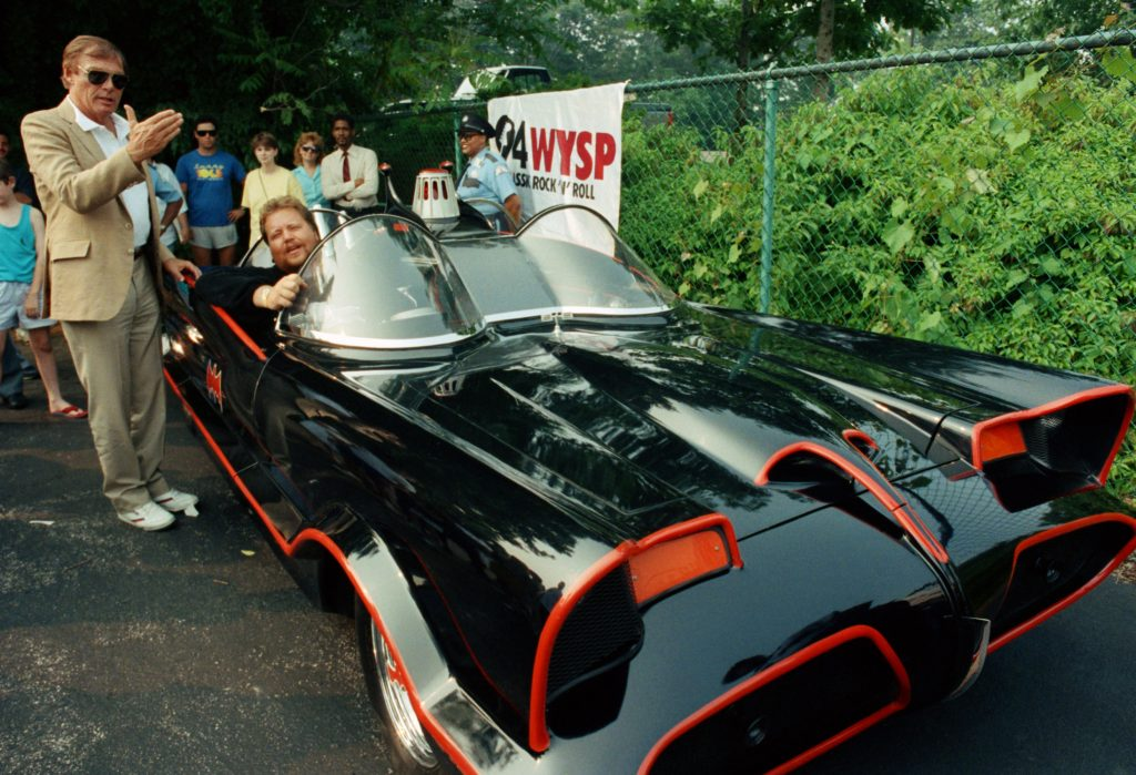 Adam West, left, stands beside the old Batmobile driven by owner Scott Chinery in Philadelphia in 1989.