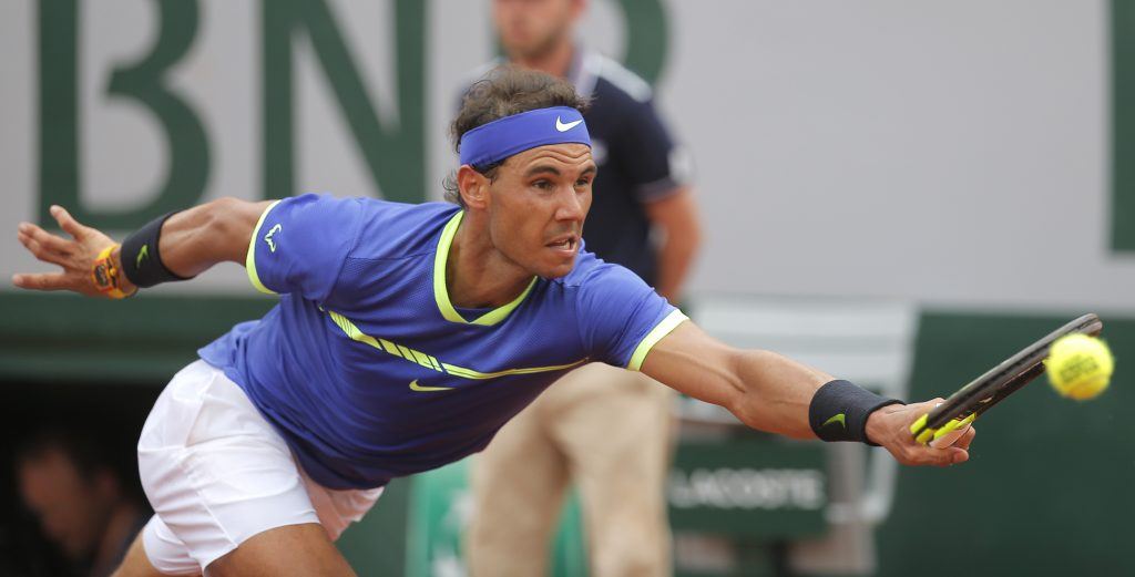 Spain's Rafael Nadal stretches to return the ball to Switzerland's Stan Wawrinka during their final match of the French Open at the Roland Garros stadium on Sunday in Paris.