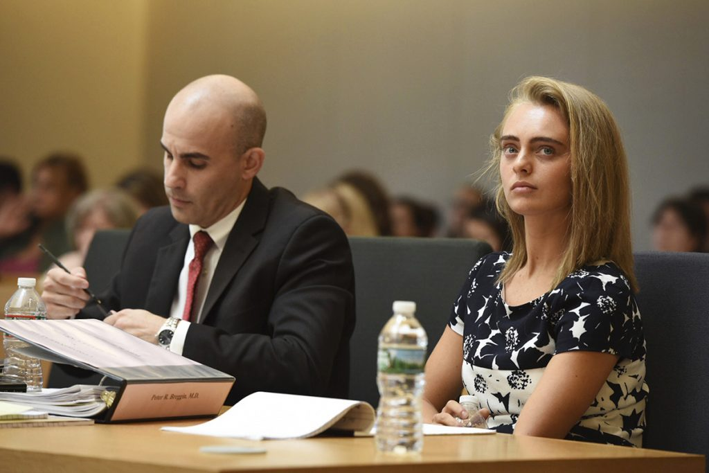 Defense Attorney Cory Madera takes notes as defendant Michelle Carter listens during her trial at Taunton Juvenile Court  in Taunton, Mass., Monday.