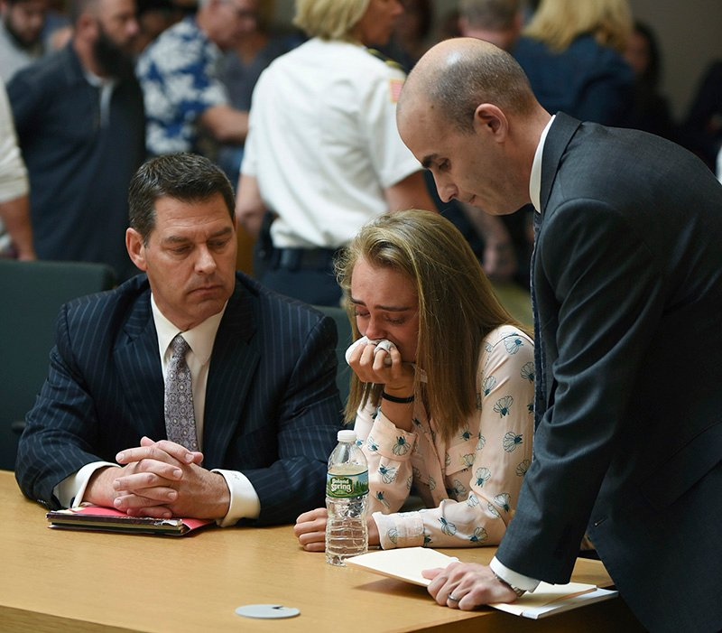 Michelle Carter cries while flanked by defense attorneys Joseph Cataldo, left, and Cory Madera, after being found guilty of involuntary manslaughter on Friday.