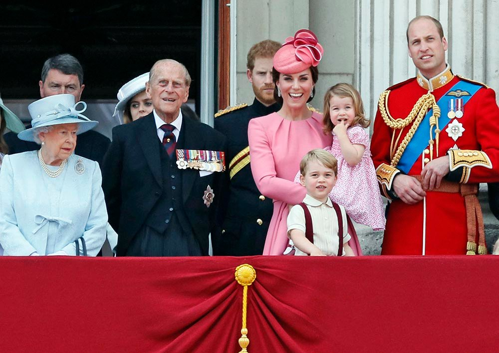 Members of the British royal family – from left, Queen Elizabeth II, Prince Philip, Prince Harry, Princess Kate, The Duchess of Cambridge, with children Prince George and Princess Charlotte and Prince William – gather on the balcony of Buckingham Palace, after attending the annual Trooping the Colour Ceremony in London on Saturday.