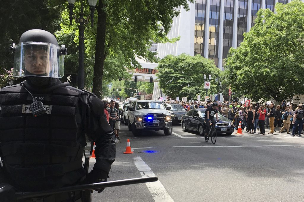 Thousands of protesters gather in Portland, Ore., for competing rallies on June 4 after the fatal stabbing of two men on a train by a man police say was shouting anti-Muslim slurs. Marches against Islamic law are scheduled in more than two dozen cities across the United States.