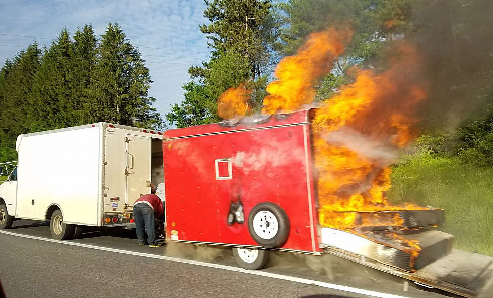 A mover's 8-foot utility trailer full of furniture and clothes caught on fire around 7 a.m. and was destroyed along with a stretch of pavement on Interstate 95 and a Department of Transportation sign. While the cause is undetermined, the fire appears to have started in the axle.